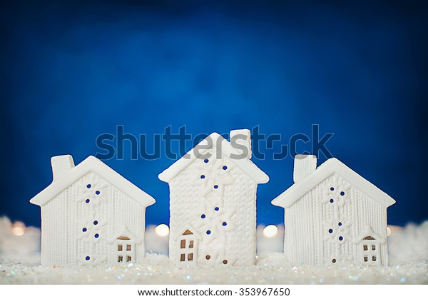 New Year background with cottages in the snow