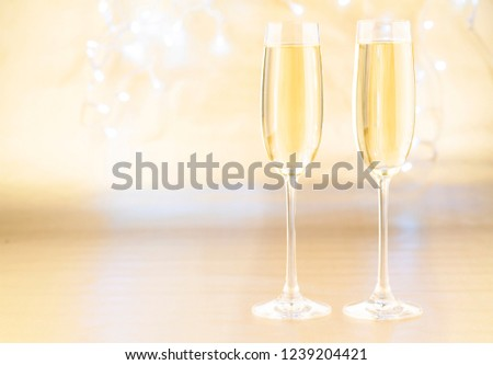 new year background with glasses of champagne golden holiday background