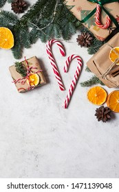 new year background white background new year Christmas lollipops Christmas tree gifts orange cinnamon new year mood garland decoration