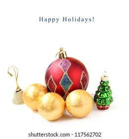 New Year balls, bell and toy fir on white background