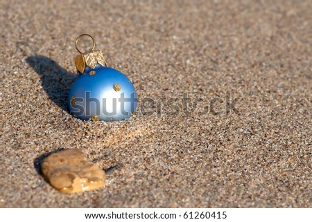 new year at the beach christmas ornaments standing in the sand near the water - Beach Christmas Ornaments
