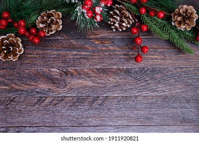 new year brown wooden background with green tree and red berries