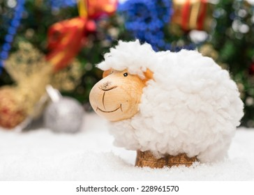 New year card with a sheep a symbol of 2015 on christmas decoration