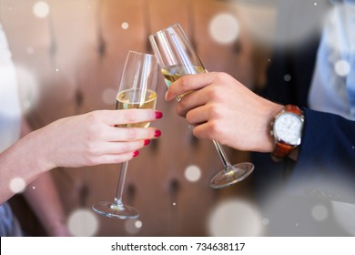 new year celebration or dating concept - close up of champagne glasses in male and female hands