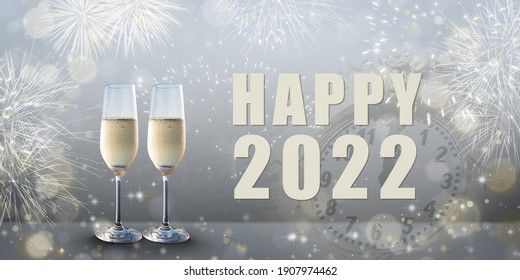 New Year celebration: Glasses of champagne and Happy 2022 text. Fireworks and clock in the background.