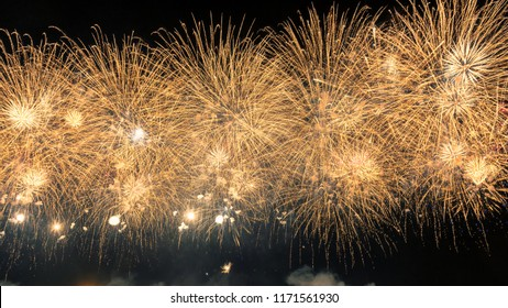 New Year celebration gold color fireworks and copy space - abstract holiday background