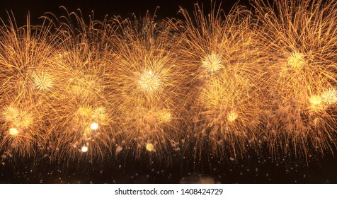 New Year celebration gold color firework with copy space for , Abstract holiday background.