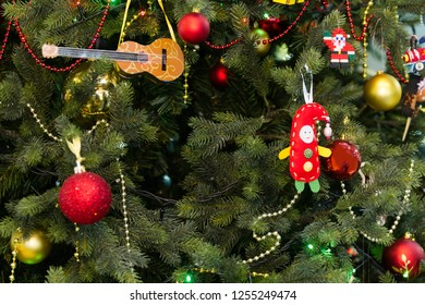 New Year. Celebration. Toys hang on the Christmas tree, background