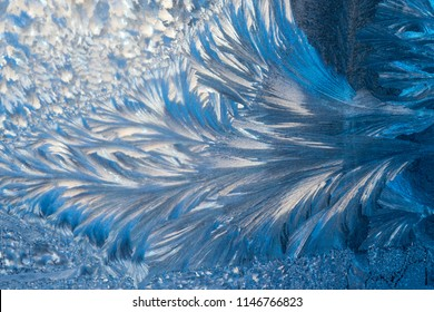 New Year and Christmas abstract icy snowy background with real ice crystals macro in cold blue tones