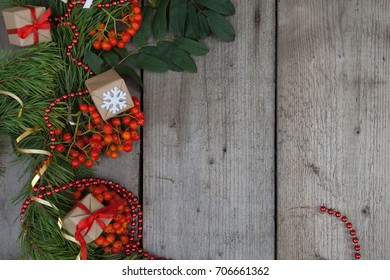 New year and Christmas background. Branches of the spruce and red ash with gifts and Christmas beads