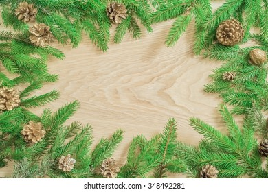 New Year and Christmas background of fir branches , cones , fruits and berries. Spruce paws covered with snow .