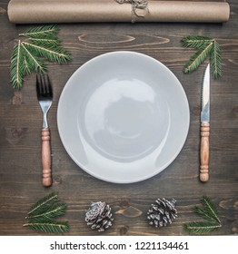New Year or Christmas concept, cutlery on a red napkin on a plate