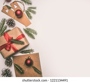 New Year or Christmas concept of gift wrapping, paper, envelopes, Christmas tree branches, on a white background, place for text flat lay