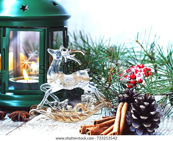 new year christmas decor ornaments cinnamon  candles lying on boards rustic tinted