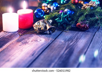New Year Christmas. Decorated Christmas tree, Christmas bell, presents, candles, gifts. Shallow depth of field. Festive bokeh. Christmas bokeh