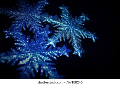 New Year and Christmas decoration. Flickering snowflake