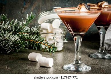 New Year and Christmas drinks idea, Toasted smores martini, dark background, copy space