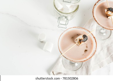 New Year and Christmas drinks idea, Toasted smores martini, white background, copy space top view