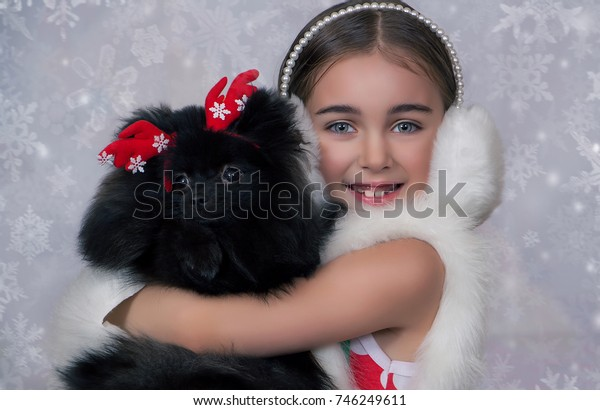 new year, Christmas portrait of a girl with a dog, deer