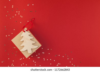 New Year or Christmas present flat lay top view Xmas holiday 2019 celebration handmade gift box red paper golden sparkles background copyspace. Template mockup for greeting card your text design
