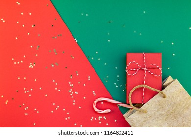 New Year or Christmas presents preparation DIY flat lay top view Xmas holiday celebration handmade gift boxes on red green paper background. Template mockup for greeting card or your text design 2019