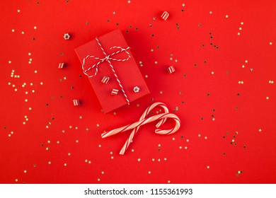 New Year or Christmas presents wrapped ribbon flat lay top view 2019 Xmas holiday celebration handmade gift boxes red paper golden sparkles background. Template mockup greeting card your text design
