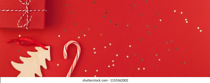 New Year or Christmas presents wrapped ribbon flat lay top view Xmas 2019 holiday celebration handmade gift boxes red paper golden sparkles background copyspace. Template mockup long wide banner