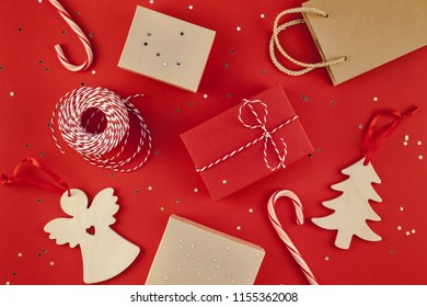 New Year Christmas presents wrapped ribbon flat lay top view Xmas holiday 2019 celebration handmade gift boxes red paper golden sparkles background copyspace. Template mockup greeting card text design