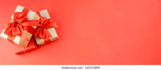 New Year Christmas presents wrapped ribbon flat lay top view Xmas holiday 2019 celebration handmade gift boxes red paper golden sparkles background copyspace. Template mockup greeting card text design - Shutterstock ID 1237213099