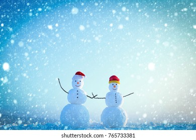 new year christmas snow concept new year christmas snow concept Santa claus hat in winter. Christmas or xmas decoration. New year snowmen from snow in santa hat. Happy holiday and celebration. Snowman