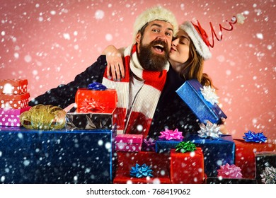 new year christmas snow concept Couple in love in santa hat, family relations. Winter holiday celebration. Xmas party and love. Christmas man and woman couple at present box. New year guy and girl