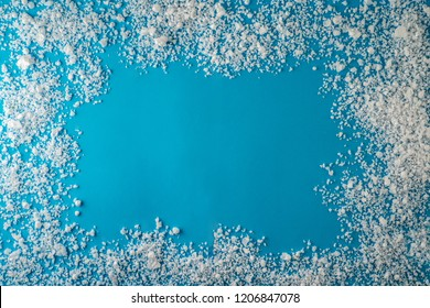 New Year and Christmas winter cold icy frost snow frame on blue background with space for text