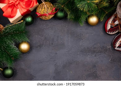 New year and christmas wreaths and gifts on black textured background, unique multicolored silk shakrfs, free space for design