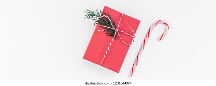 New Year Christmas Xmas 2019 holiday celebration red present gift box candy cane green fir tree branch copy space isolated white background minimal style. Template greeting card. Long wide banner