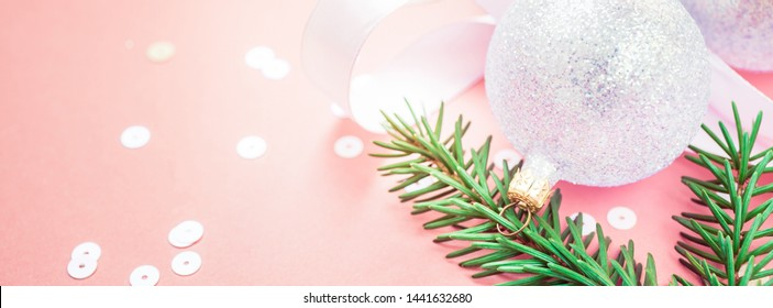 New Year Christmas Xmas holiday celebration composition pearl decorative toy balls green fir branch sparkles confetti pink paper background copy space Template text design Long wide banner