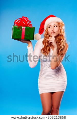 new year christmas x mas woman in santa helper hat with present