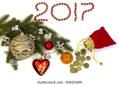 New Year and Christmas.Branches with garland,bell and clock lay on a white background.Horizontal frame.