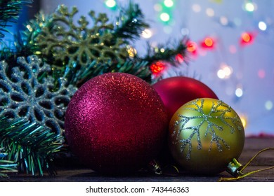 New year and Christmas.Christmas toys and twigs of Christmas tree on wooden table