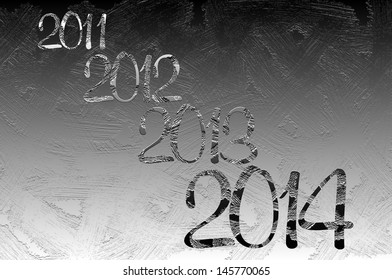 New year coming, texture of frozen window with passed years and coming 2014 in foreground
