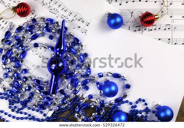 new year composition Christmas tree decorations on the table and sheet with music notes