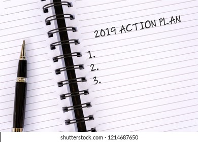 New Year concept - 2019 Action plan text on notepad with pen.