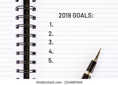 New Year concept - 2019 Goals on notepad with pen.