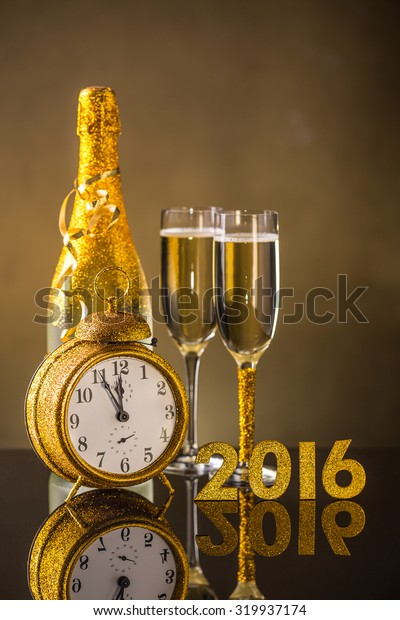 New Year concept - champagne, 2016 text and clock