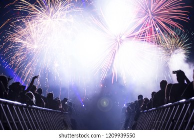 New Year concept with cheering crowd and fireworks