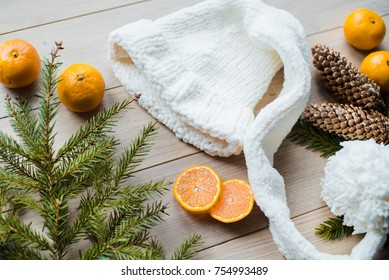 New Year Concept. Christmas decorations from fir-tree branches and the fruits of mandarin orange on wooden background