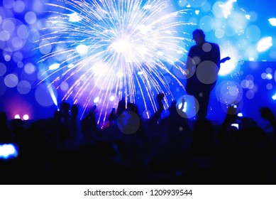 New Year concept with fireworks, live concert,  crowd, guitarist on stage