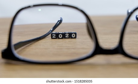 New year concept with glasses in selective focus