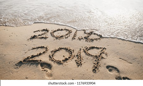 New Year concept. Happy New Year 2019 replace 2018 written on sandy beach