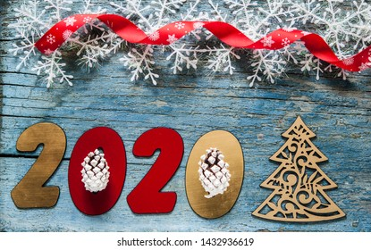 New year concept - Number 2020 for New Year and decoration on a wooden table. With vintage styled background.