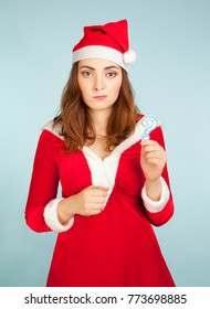 New year concept woman in santa costume holding a question mark